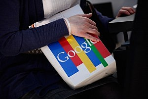 A visitor clutches a paper bag from online giant Google at the CeBIT technology trade fair on March 1, 2011 in Hanover, Germany.