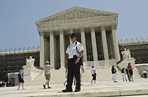 A Supreme Court Police officer stands outside the U.S. Supreme Court on June 28, 2012 in Washington, DC.
