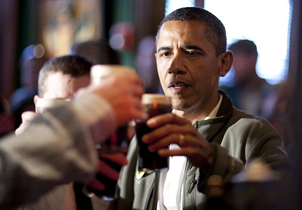President Barack Obama toasts with  beer